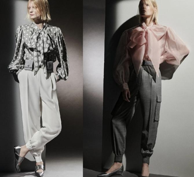 элегантные женские образы с модных показов 2021 года - блузки с галстуками-бантами в романтическом стиле в ансамбле со свободными брюками на кулиске